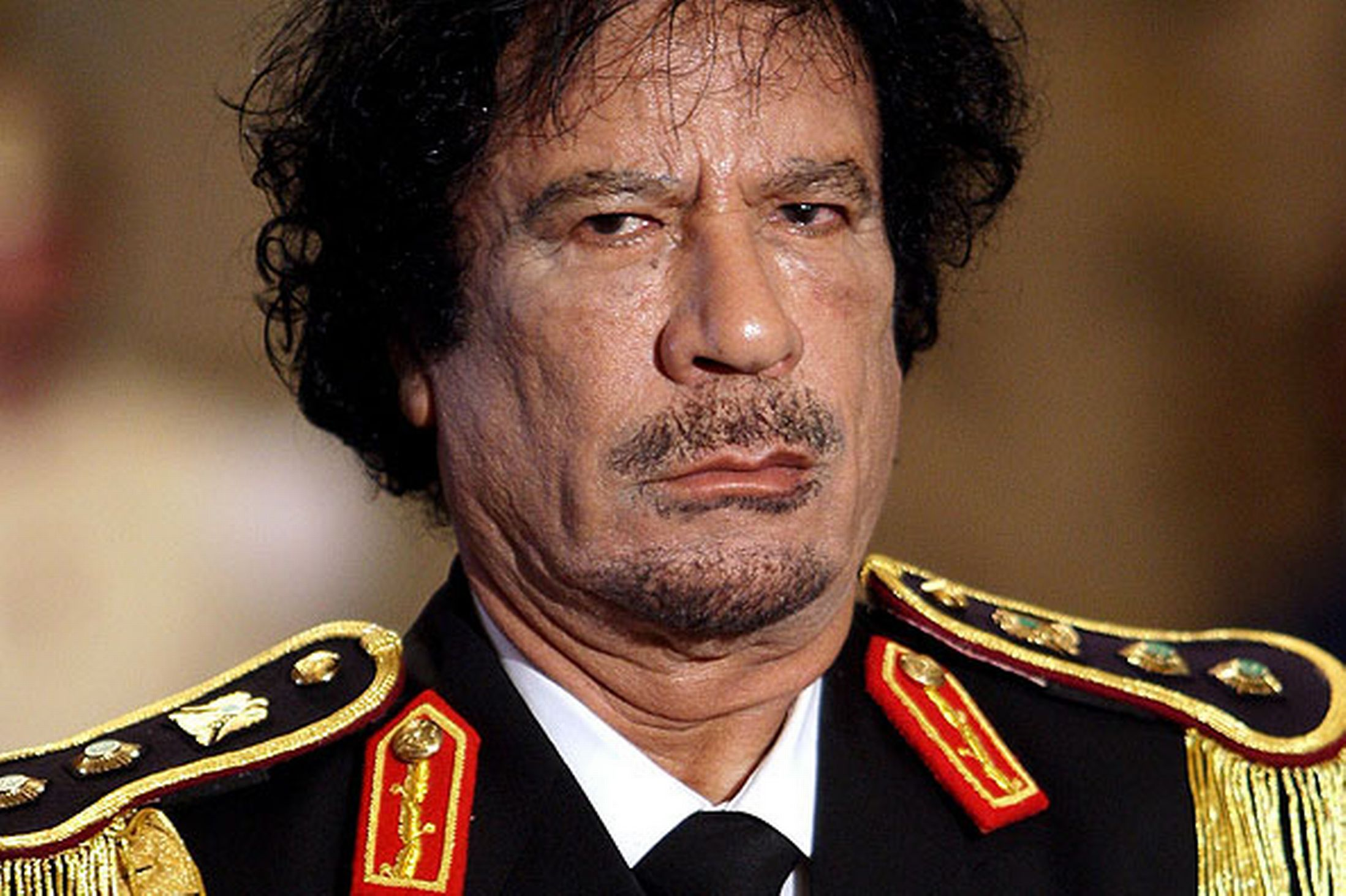 gaddafi of libya do wrong things Libyan leader muammar gaddafi is facing the most serious threat to his  four decade old rule in libya with opposition forces taking over.